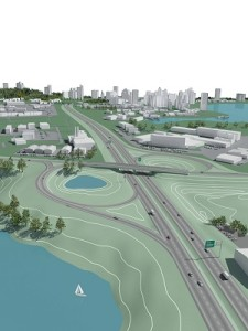 Civil 3D 2010 hero image. The image shows a half cloverleaf highway interchange  including an overpass bridge. The main highway is an eight lane divided highway. There is a lake in the foreground, and several towns in the background.